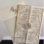 Rose laser cut wedding invitation by Charu